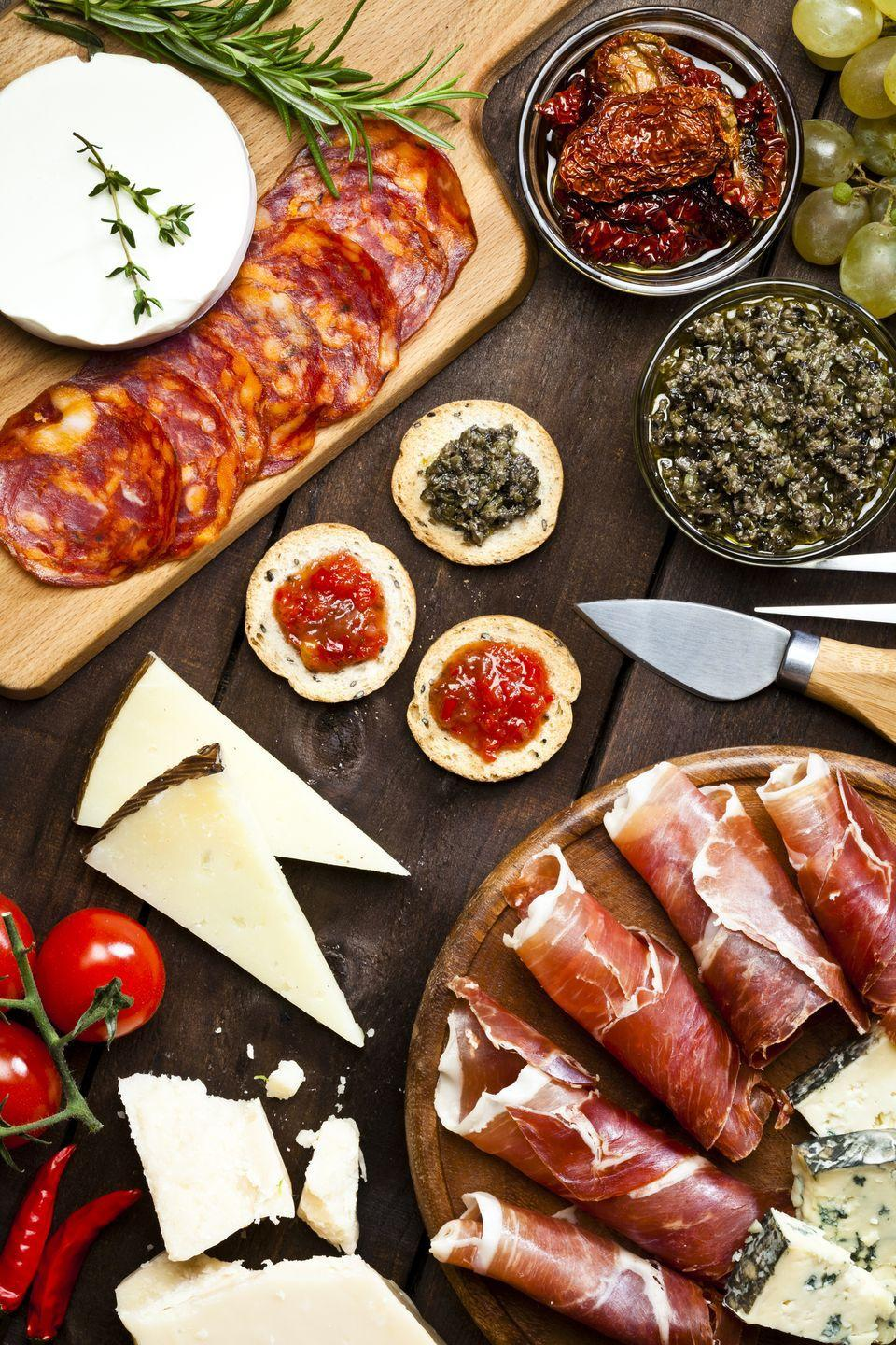 """<p>Whip up a bunch of different tapas instead of a big dinner so that you can taste as much as you want.</p><p><a class=""""link rapid-noclick-resp"""" href=""""https://www.amazon.com/Unique-Charcuterie-Platter-Serving-Crackers/dp/B0723B35QQ/?tag=syn-yahoo-20&ascsubtag=%5Bartid%7C10050.g.30445302%5Bsrc%7Cyahoo-us"""" rel=""""nofollow noopener"""" target=""""_blank"""" data-ylk=""""slk:SHOP CHEESE BOARDS"""">SHOP CHEESE BOARDS</a></p>"""