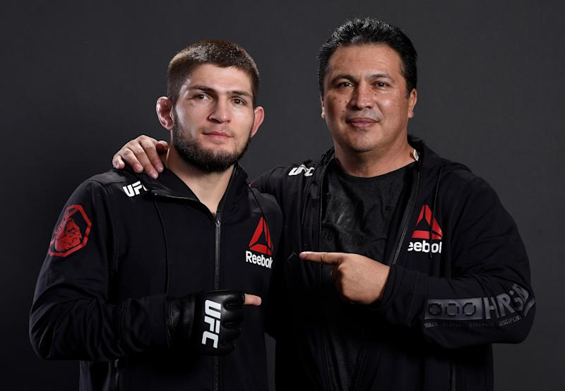 LAS VEGAS, NV - DECEMBER 30: Khabib Nurmagomedov of Russia poses for a portrait backstage with coach Javier Mendez after his victory over Edson Barboza during the UFC 219 event inside T-Mobile Arena on December 30, 2017 in Las Vegas, Nevada. (Photo by Mike Roach/Zuffa LLC/Zuffa LLC via Getty Images)