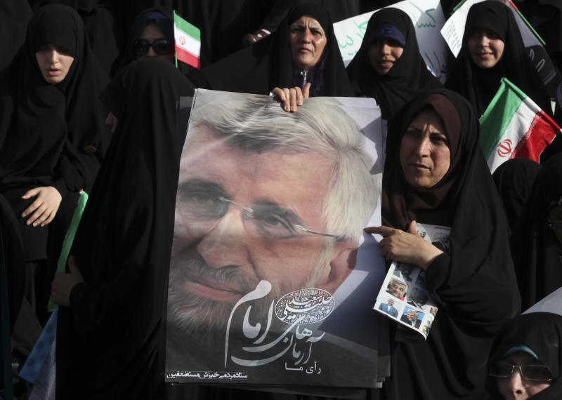 Female supporters of the Iranian presidential candidate Saeed Jalili, a nuclear negotiator, attend a campaign rally, two days prior to the election, in Tehran, Iran, Wednesday, June 12, 2013. (AP Photo/Vahid Salemi)