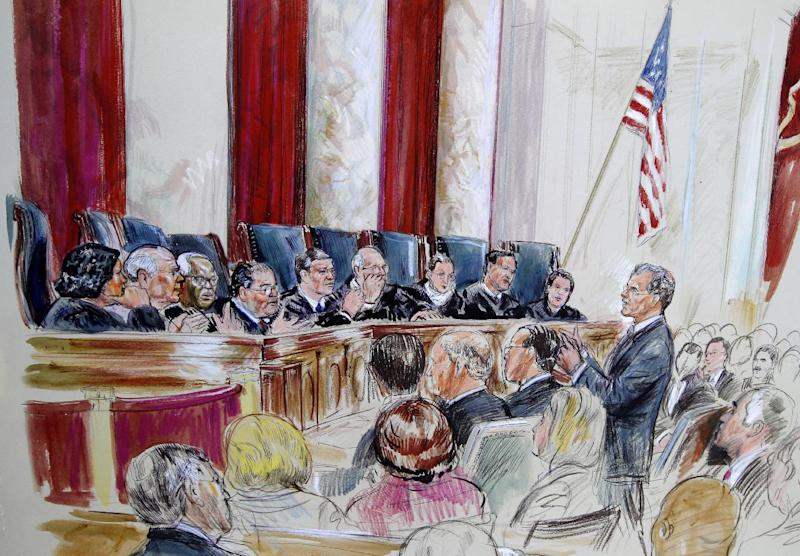 Solicitor General Donald B. Verrilli, Jr., speaks in front of the Supreme Court in Washington, Tuesday, March 27, 2012, as the court continued hearings on the health care law signed by President Barack Obama. Justices, seated from left are, Sonia Sotomayor, Stephen Breyer, Clarence Thomas, Antonin Scalia, Chief Justice John Roberts, Anthony Kennedy, Ruth Bader Ginsburg Samuel Alito and Elana Kagan. (AP Photo/Dana Verkouteren)