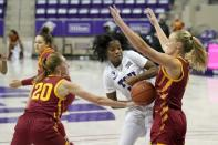 Iowa State guard Aubrey Joens (20) and guard Madison Wise, right, combine to strip the ball away from TCU guard Tavy Diggs, center, in the second half of an NCAA college basketball game in Fort Worth, Texas, Wednesday, Dec. 2, 2020. (AP Photo/Tony Gutierrez)
