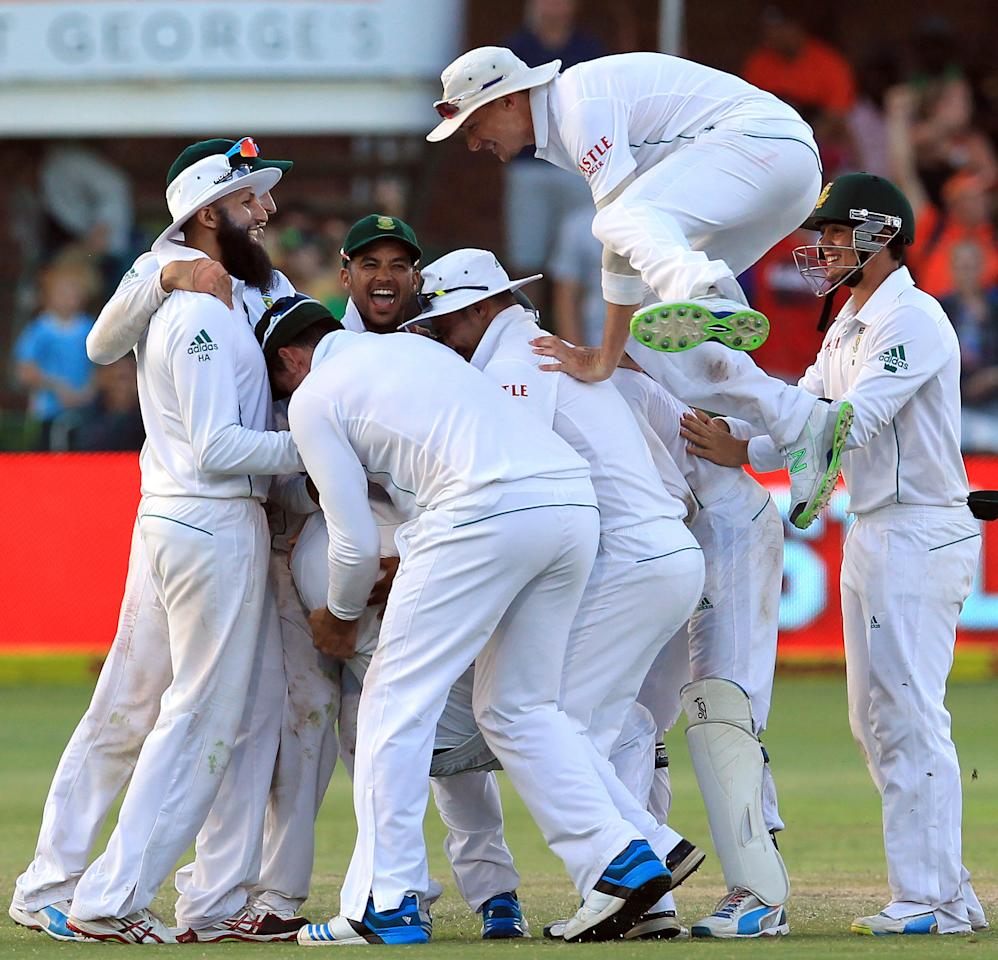 South Africa's players celebrate the winning wicket on the fourth day of their 2nd cricket test match at St George's Park in Port Elizabeth, South Africa, Sunday, Feb. 23, 2014. South Africa beat Australia by 231 runs. (AP Photo/ Themba Hadebe)