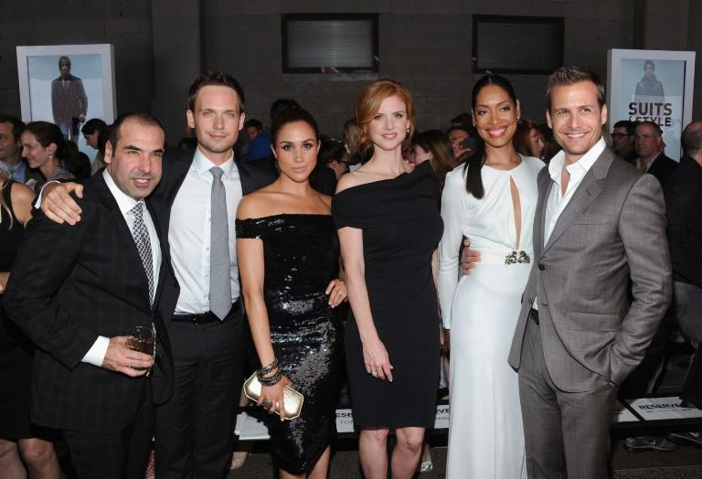 """Markle is pictured with the cast of """"Suits"""", the US legal drama series she'd starred in since 2011 and which Prince Harry admitted never watching"""