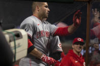 Cincinnati Reds first baseman Joey Votto (19) is greeted by his teammates after hitting a solo home run against the San Francisco Giants during the sixth inning of a baseball game, Monday, April 12, 2021, in San Francisco, Calif. (AP Photo/D. Ross Cameron)