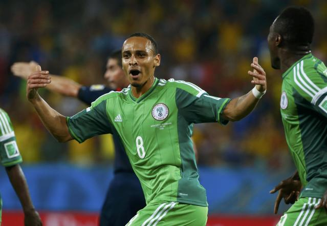 Nigeria's Peter Odemwingie celebrates scoring his goal against Bosnia during their 2014 World Cup Group F soccer match at the Pantanal arena in Cuiaba June 21, 2014. REUTERS/Michael Dalder (BRAZIL - Tags: SOCCER SPORT WORLD CUP TPX IMAGES OF THE DAY)
