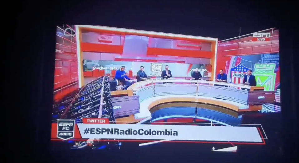 ESPN Colombia journalist Carlos Orduz avoided a major injury after a TV set collapsed on him Tuesday. (@RojasManuel)