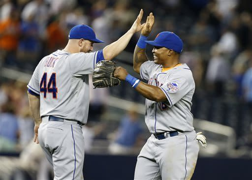 CORRECTS BUCK'S POSITION - New York Mets right fielder Marlon Byrd, right, celebrates with designated-hitter John Buck (44) after the the Mets defeated the New York Yankees 3-1 to complete a four game sweep after an interleague baseball game series at Yankee Stadium in New York, Thursday, May 30, 2013. (AP Photo/Kathy Willens)