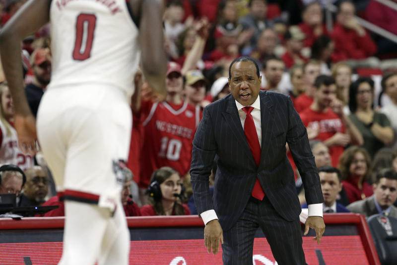 North Carolina State head coach Kevin Keatts dirtects his players during the second half of an NCAA college basketball game against Miami in Raleigh, N.C., Wednesday, Jan. 15, 2020. (AP Photo/Gerry Broome)