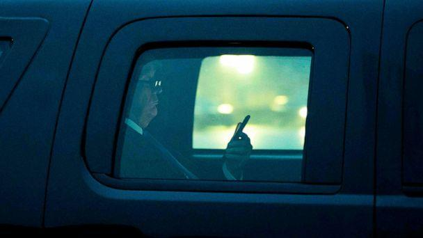PHOTO: President Donald Trump, with reading glasses, looks at his cellphone as he departs the White House for a campaign trip to Milwaukee, Jan. 14, 2020.  (Doug Mills/The New York Times via Redux Pictures)