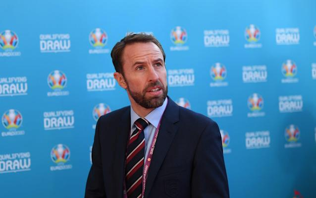 """Gareth Southgate has called on his players to seize their """"great chance"""" to finally end the nation's 52-year wait for a major trophy after England were granted a favourable-looking passage to the European Championships. England take on Czech Republic, Bulgaria, Montenegro and Kosovo next year and, should they qualify, are guaranteed at least two finals matches at Wembley. The stadium, one of 12 Euro 2020 host cities, has been ordered by Uefa to relay the pitch after concerns were raised about the playing surface. Reflecting on the Euro 2020 draw, Southgate said his squad must capitalise their opportunities over the next 18 months, which also sees them with a golden chance to win the first Uefa Nations League. England find out at 1.30pm on Monday whether they play Switzerland, Holland or Portugal in the semi-finals of the new contest. Jason Burt's Euro 2020 draw verdict: Group-by-group breakdown """"I think it can be a really exciting 18 months,"""" Southgate added. """"We've got this coming summer to look forward to and then a big chance because we host and we have to make sure we are there. """"That could be an incredibly exciting two year period from the World Cup right through and a great opportunity for our players."""" He said the prospect of qualification """"should be motivation enough to make sure the performances are right."""" England have never played the Czechs in a competitive match since the break-up of Czechoslovakia, with one win and one draw from two previous friendly encounters. Similarly, they have not faced Kosovo, who only gained Fifa membership in 2016. """"We're favourites and that's something we've got to start getting used to any way,"""" said Southgate. """"We're going to have high expectations over the next few years and adapting to that is probably key to our development as a team now."""" England could play at Wembley up to five times during the finals, which is being shared between 12 European host cities including Glasgow and Dublin. Southgate, a member of the Euro 96"""