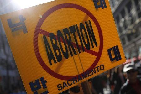 Anti-abortion sign is seen as demonstrators march during the Ninth Annual Walk for Life West Coast rally in San Francisco