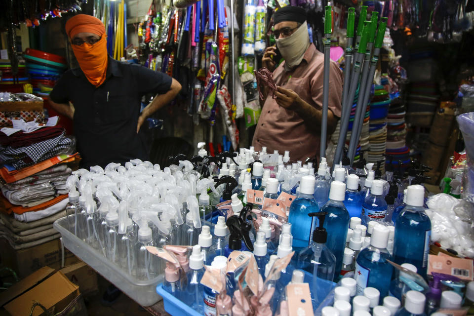Hand sanitizers and empty containers are displayed for sale in Kolkata, India, Friday, June 19, 2020. India is the fourth hardest-hit country by the COVID-19 pandemic in the world after the U.S., Russia and Brazil. (AP Photo/Bikas Das)