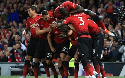 Manchester United's Luke Shaw is mobbed by teammates after scoring his sides second goal of the game during the English Premier League soccer match between Manchester United and Leicester City at Old Trafford, in Manchester, England, Friday, Aug. 10, 2018 - Credit: AP