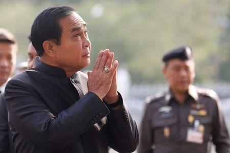 Chan-ocha gestures in a traditional greeting as he arrives at a weekly cabinet meeting at the Government House in Bangkok
