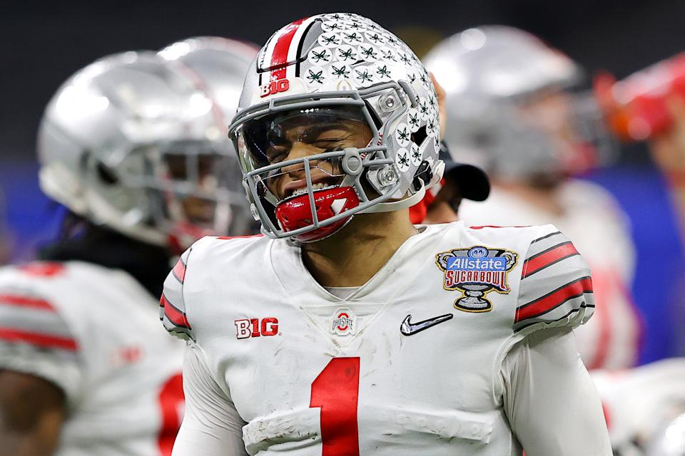 Ohio State's Justin Fields reacts after a hit against Clemson in the first half of the College Football Playoff semifinal game on Jan. 1. (Kevin C. Cox/Getty Images)