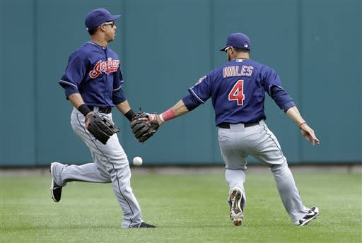 Cleveland Indians shortstop Mike Aviles (4) and left fielder Michael Brantley chase a blooper hit by Detroit Tigers' Omar Infante to load the bases during the third inning of a baseball game in Detroit, Saturday, June 8, 2013. (AP Photo/Carlos Osorio)