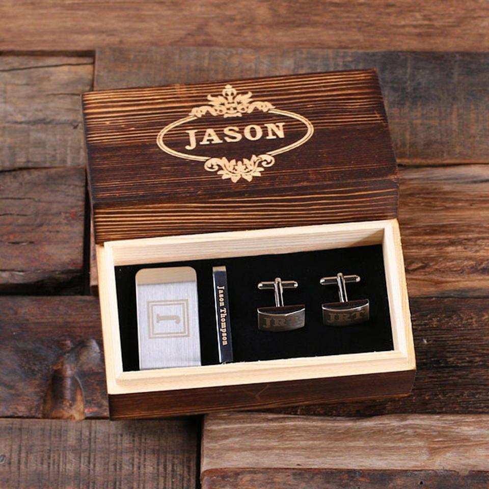 """<p><strong>TealsPrairie</strong></p><p>etsy.com</p><p><strong>$38.49</strong></p><p><a href=""""https://go.redirectingat.com?id=74968X1596630&url=https%3A%2F%2Fwww.etsy.com%2Flisting%2F574020857%2Fgentlemans-gift-set-cuff-links-money&sref=https%3A%2F%2Fwww.bestproducts.com%2Flifestyle%2Fg27420749%2Fengraved-gifts%2F"""" rel=""""nofollow noopener"""" target=""""_blank"""" data-ylk=""""slk:Shop Now"""" class=""""link rapid-noclick-resp"""">Shop Now</a></p><p>He'll look extra spiffy on formal occasions sporting a customized set of polished stainless steel cuff links, tie clip, and money clip. They all come encased in a wooden keepsake box that <em>also</em> happens to be engraved. </p>"""