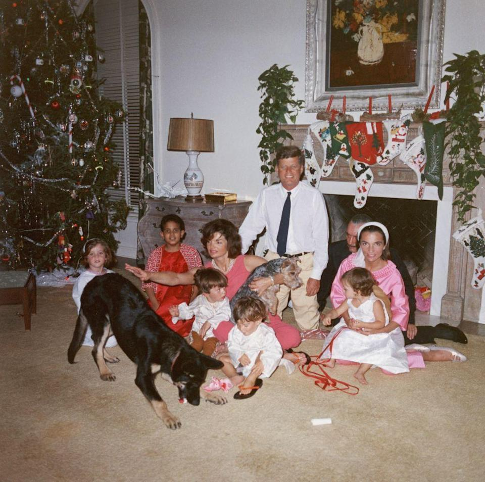 <p>Jackie and John with her sister Lee and her husband Stanislaw Radziwill and their children at Christmas.</p>