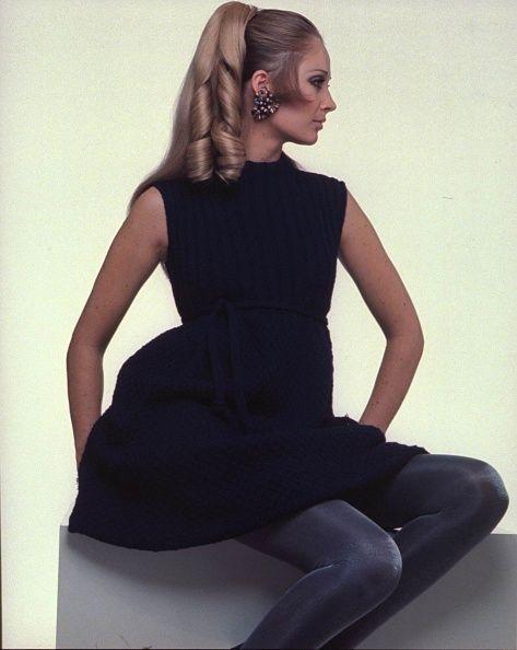 <p>Sideburns became a popular hairstyle in the late '60s and throughout the '70s, but usually this style wasn't worn by women. However, this model makes the case for a unisex look with barrel curls.</p>