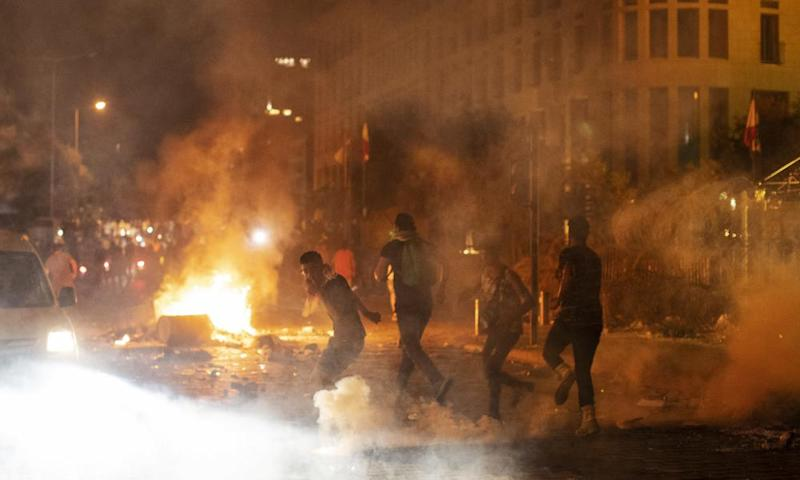 Riot police fire tear gas at anti-government protesters in Beirut on Thursday night.