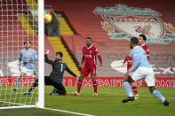 Manchester City's Raheem Sterling 2nd right, scores his side's third goal during the English Premier League soccer match between Liverpool and Manchester City at Anfield Stadium, Liverpool, England, Sunday, Feb. 7, 2021. (AP photo/Jon Super, Pool)