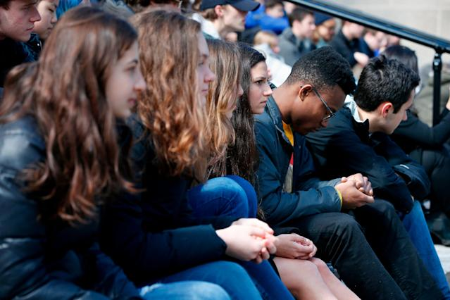 <p>Harvard University students observe a moment of silence during a protest against school shootings and gun violence on the steps of Widener Library on campus in Cambridge, Mass., Friday, April 20, 2018. (Photo: Michael Dwyer/AP) </p>