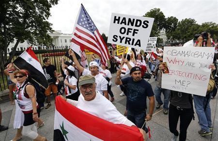 Syrian-American demonstrators march against U.S. military intervention in Syria in front of the White House in Washington