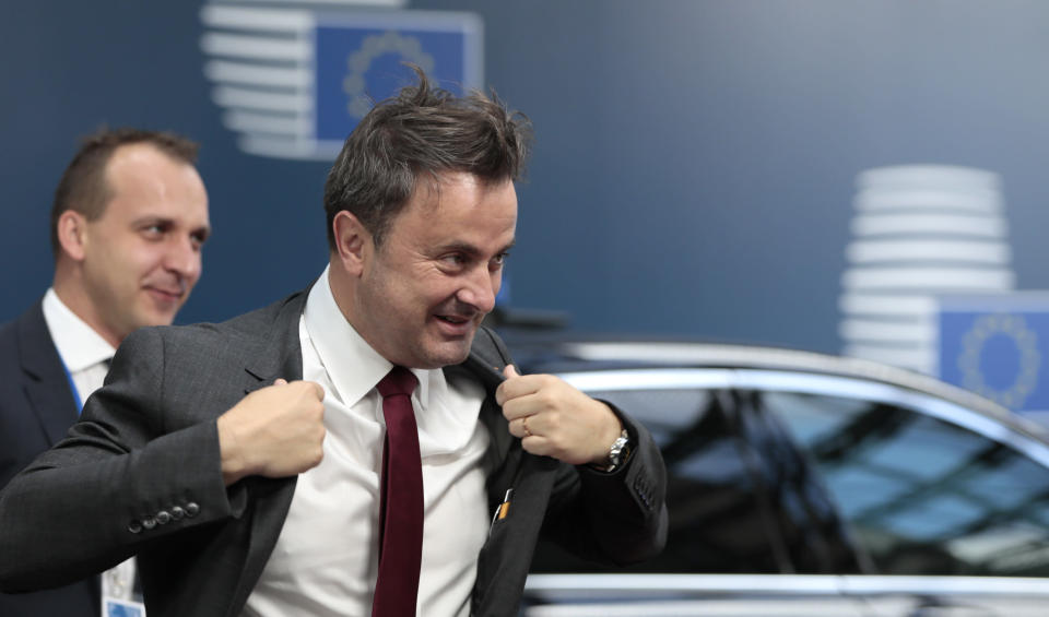 Luxembourg's Prime Minister Xavier Bettel arrives for an EU summit at the Europa building in Brussels, Friday, June 21, 2019. EU leaders conclude a two-day summit on Friday in which they will discuss the euro-area. (AP Photo/Virginia Mayo, Pool)