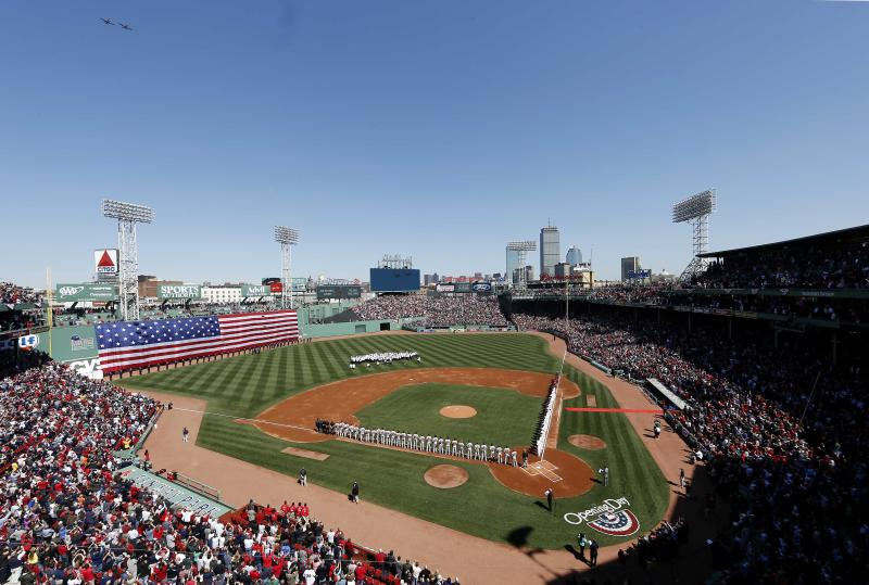 Two P-51's flyover Fenway Park during opening ceremonies before a baseball game between the Boston Red Sox and the Baltimore Orioles at Fenway Park in Boston Monday, April 8, 2013. (AP Photo/Winslow Townson)