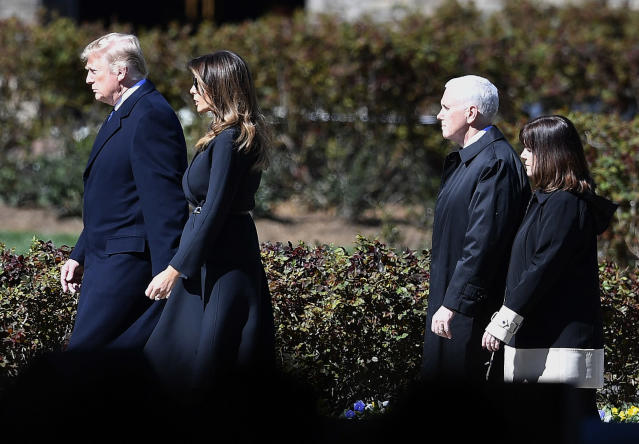 <p>President Donald Trump and First lady Melania Trump, left, and Vice President Mike Pence, and wife Karen Pence arrive ahead of a funeral service at the Billy Graham Library for the Rev. Billy Graham, who died last week at age 99, Friday, March 2, 2018, in Charlotte, N.C. (Photo: Mike Stewart/AP) </p>