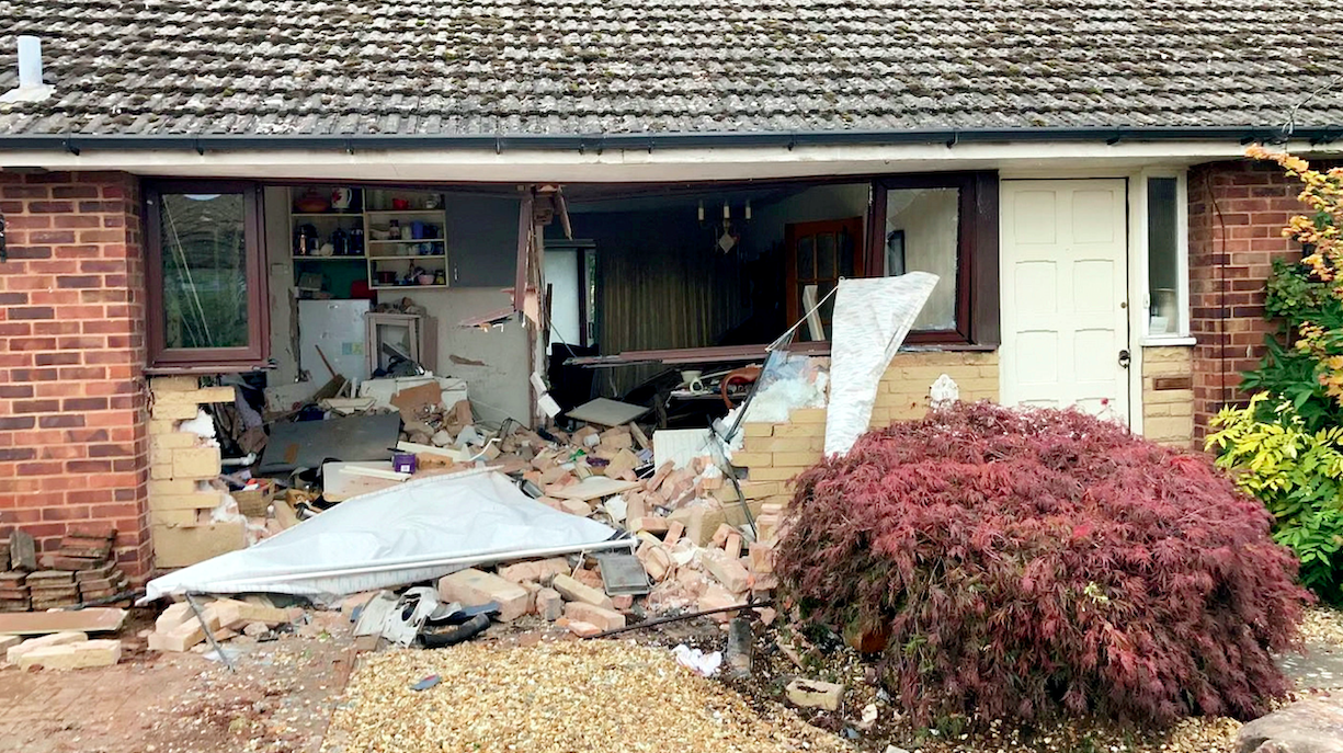 A gaping hole was left int he front of the house following the crash. (SWNS)