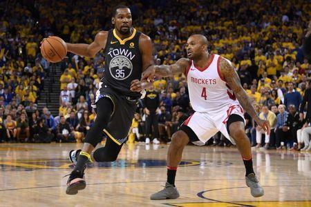 May 22, 2018; Oakland, CA, USA; Golden State Warriors forward Kevin Durant (35) drives against Houston Rockets forward PJ Tucker (4) during the fourth quarter in game four of the Western conference finals of the 2018 NBA Playoffs at Oracle Arena. Mandatory Credit: Kyle Terada-USA TODAY Sports