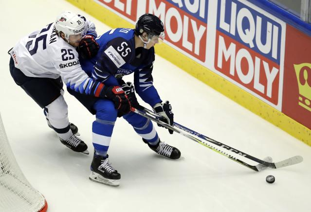 Ice Hockey - 2018 IIHF World Championships - Group B - Finland v USA - Jyske Bank Boxen - Herning, Denmark - May 15, 2018 - Mika Koivisto of Finland in action with Blake Coleman of the U.S. REUTERS/David W Cerny