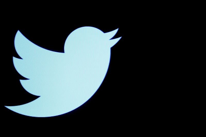 FILE PHOTO: FILE PHOTO: The Twitter logo displayed on a screen on the floor of the NYSE