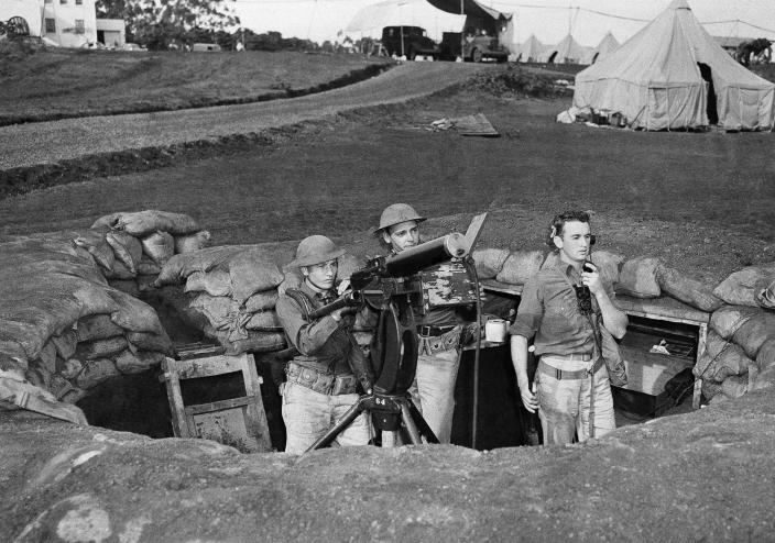 <p>Troops man a machine gun nest at Wheeler Field, which adjoins Schofield Barracks in Honolulu, after the Japanese attack on the island of Oahu, Dec. 7, 1941. (AP Photo) </p>