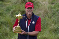 Team USA captain Steve Stricker poses with the trophy after the Ryder Cup matches at the Whistling Straits Golf Course Sunday, Sept. 26, 2021, in Sheboygan, Wis. (AP Photo/Ashley Landis)
