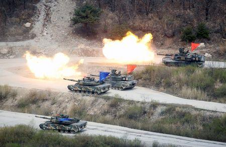 South Korean Army K1A1 and U.S. Army M1A2 tanks fire live rounds during a U.S.-South Korea joint live-fire military exercise at a training field near the DMZ in Pocheon