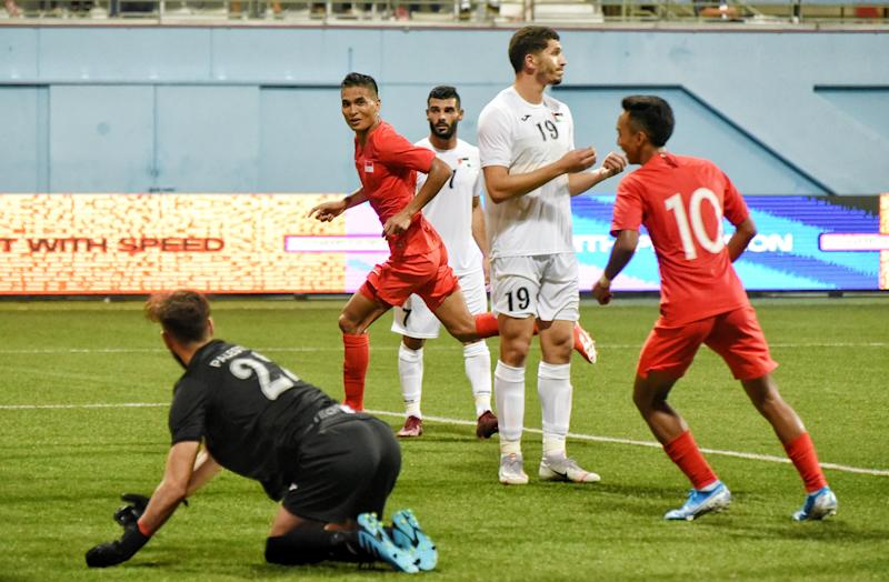 Singapore's Safuwan Baharudin (centre) wheels away after heading in the second goal in their 2022 World Cup qualifier against Palestine at the Jalan Besar Stadium. (PHOTO: Football Association of Singapore)