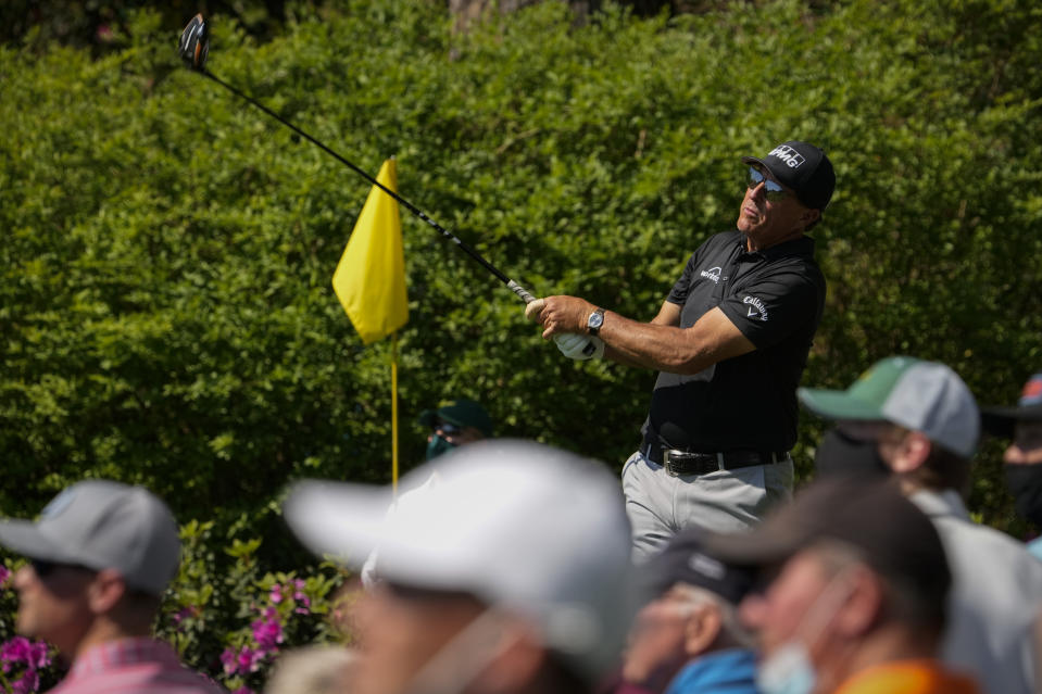Phil Mickelson watches his tee shot on the 14th hole during a practice round for the Masters golf tournament on Tuesday, April 6, 2021, in Augusta, Ga. (AP Photo/David J. Phillip)