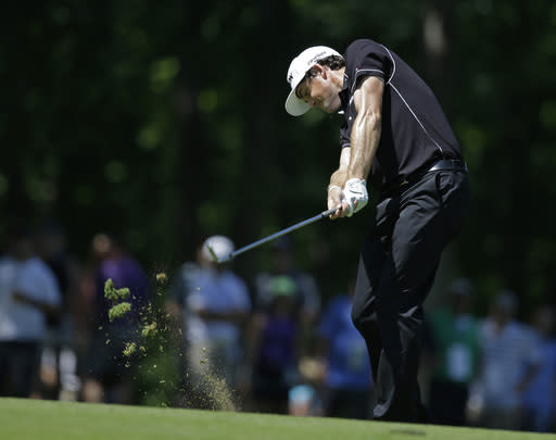 Keegan Bradley hits to the ninth green during the second round of the Memorial golf tournament Friday, May 30, 2014, in Dublin, Ohio. (AP Photo/Darron Cummings)
