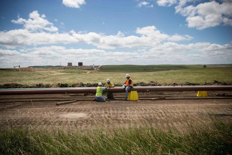 Workers build an oil pipeline in North Dakota in July 2013; the Trump adminstration is hoping to dilute environmental regulations for such major infrastructure projects (AFP Photo/Andrew Burton)