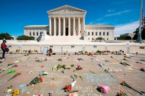 PHOTO: Messages and flowers are left outside of the Supreme Court in memory of Associate Justice Ruth Bader Ginsburg, in Washington, on Sept. 19, 2020. (Jose Luis Magana/AFP via Getty Images)