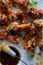 """<p>A little spicy, a little sweet...this one's a crowd pleaser.</p><p>Get the recipe from <a href=""""http://www.spoonforkbacon.com/2018/05/sticky-honey-garlic-and-chile-glazed-chicken-drumettes/"""" rel=""""nofollow noopener"""" target=""""_blank"""" data-ylk=""""slk:Spoon Fork Bacon"""" class=""""link rapid-noclick-resp"""">Spoon Fork Bacon</a>.</p>"""