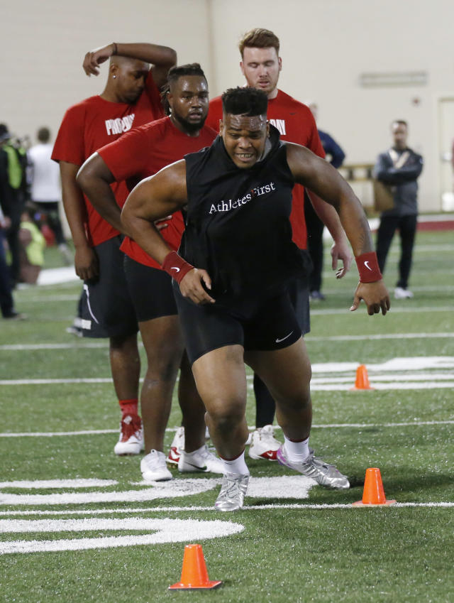 Oklahoma offensive lineman Orlando Brown participates in a drill during an NCAA college football Pro Day workout in Norman, Okla., Wednesday, March 14, 2018. Brown had a historically bad NFL Scouting Combine and is trying to improve his falling draft stock at Oklahoma's Pro Day. (AP Photo/Sue Ogrocki)