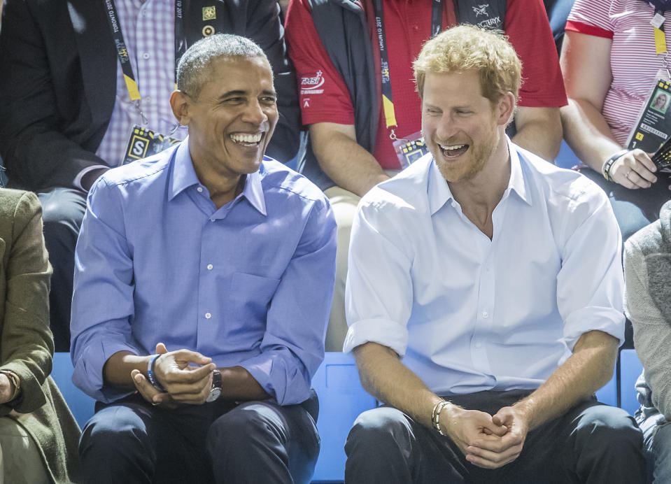 Barack Obama and Prince Harry watch wheelchair basketball at the Pan Am Sports Centre at the 2017 Invictus Games in Toronto, Canada.