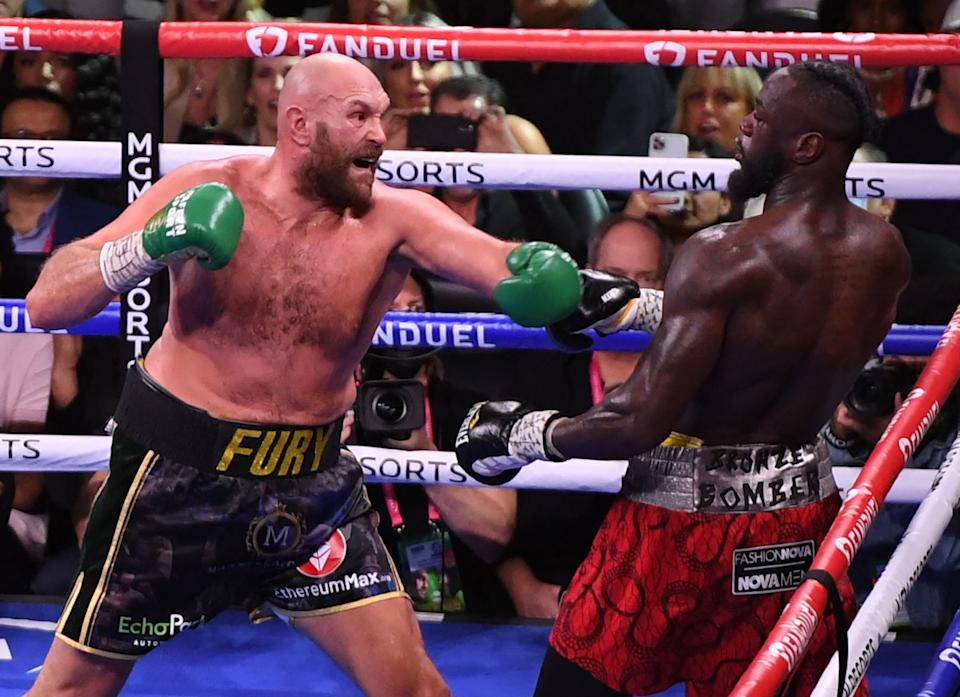 Seen here, Tyson Fury shapes up to hit Deontay Wilder in the seventh round of their WBC heavyweight trilogy fight.