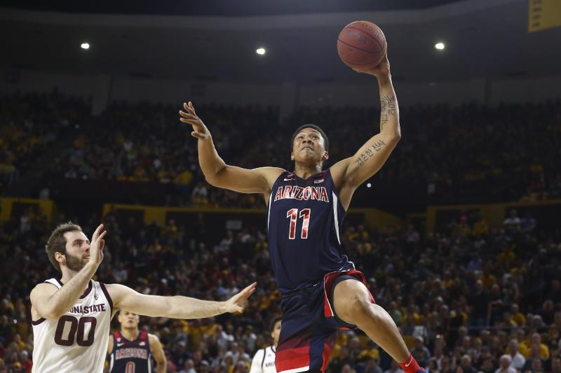 Arizona forward Ira Lee (11) goes in for a dunk as he gets past Arizona State forward Mickey Mitchell (00) during the first half of an NCAA college basketball game Saturday, Jan. 25, 2020, in Tempe, Ariz. (AP Photo/Ross D. Franklin)