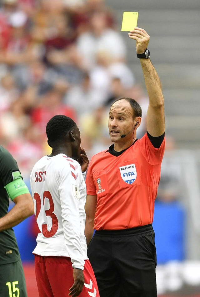 Denmark's Pione Sisto is booked by referee Antonio Mateu Lahoz from Spain during the group C match between Denmark and Australia at the 2018 soccer World Cup in the Samara Arena in Samara, Russia, Thursday, June 21, 2018. (AP Photo/Martin Meissner)