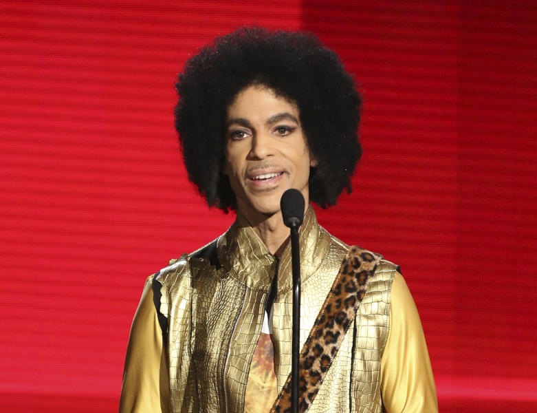 FILE - In this Nov. 22, 2015, file photo, Prince presents the award for favorite album - soul/R&B at the American Music Awards in Los Angeles. Prince died at his home in Chanhassen, Minn. on April 21, 2016 at the age of 57. (Photo by Matt Sayles/Invision/AP, File)