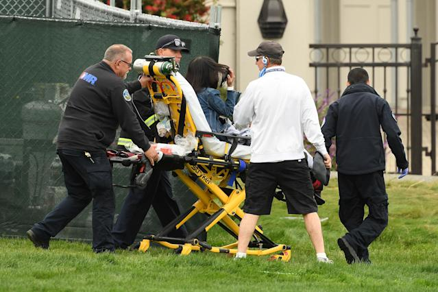 A spectator needed medical attention after being struck by a rogue golf cart on Friday at the U.S. Open. (Photo by Ross Kinnaird/Getty Images)